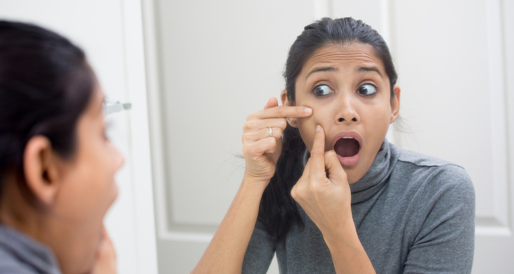Removing the pus from a pimple